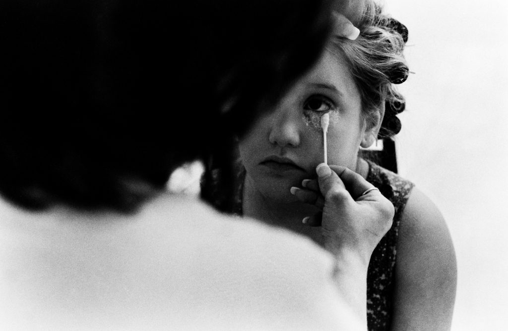 04/10/04 Every time Diana and her daughter touch Sabrina, it costs Michelle $50. A typical pageant weekend costs Michelle $150, for an initial makeup session the day of the pageant, a touch up before the second outfit, and the crowning ceremony the next day. photo by Rebecca Hazelwood