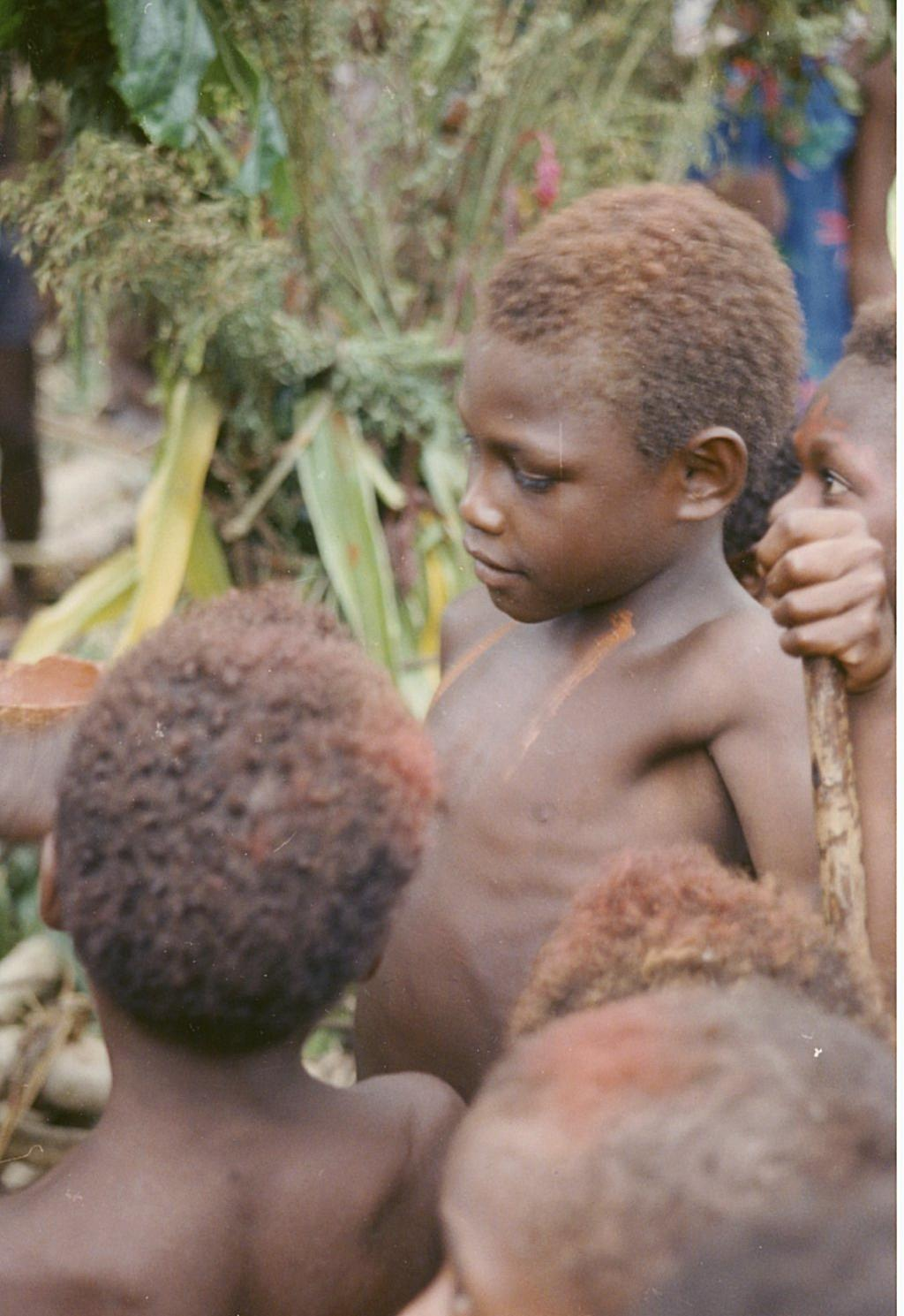 Boy marked with red ochre during taro ritual
